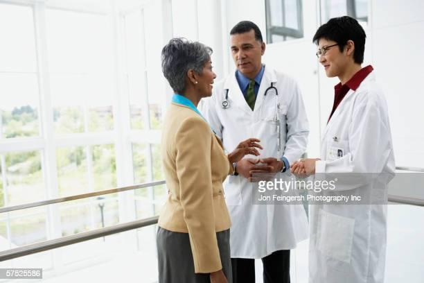 Doctors talking to businesswoman
