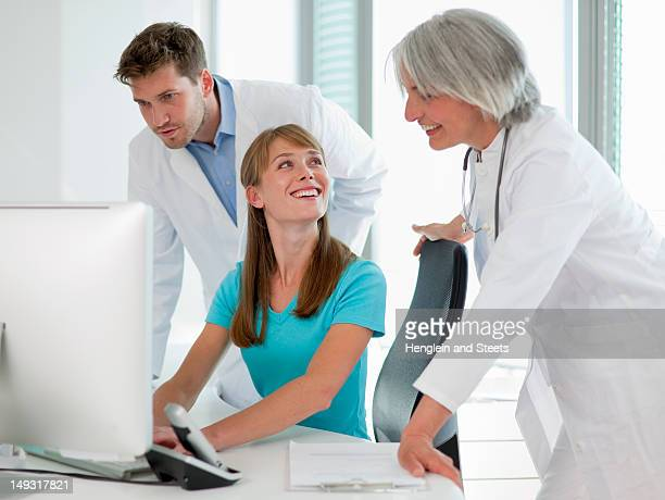 Doctors talking to receptionist