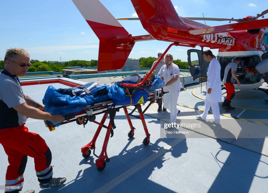 Doctors tend to a man who had fallen and hit his head and had been delivered by a DRF emergency air service helicopter to the Unfallkrankenhaus Berlin (UKB) hospital in Marzahn district on June 17, 2013 in Berlin, Germany. The UKB hospital has among the most modern emergency care services in Germany.