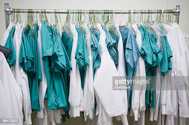 Doctor's uniforms hanging on a clothes rack