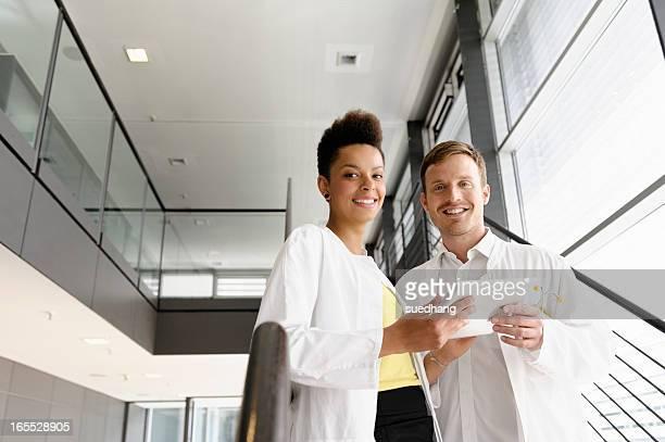 Doctors using tablet computer