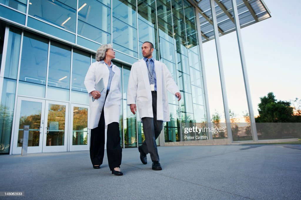Doctors walking together outdoors