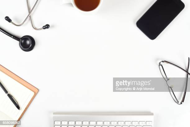 Doctors White Office Desk Table With Many Things On It, Top View With Copy Space