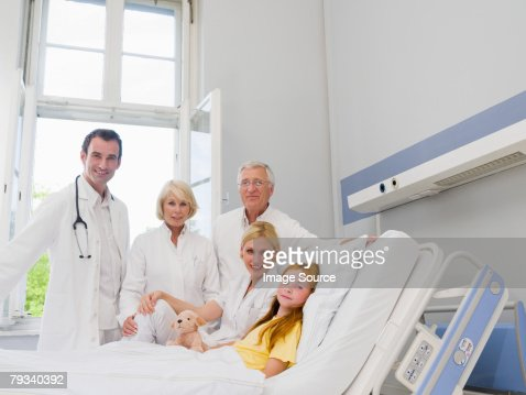 Doctors with a patient : Stock Photo