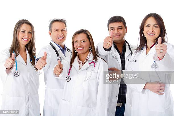 Doctors with thumbs up