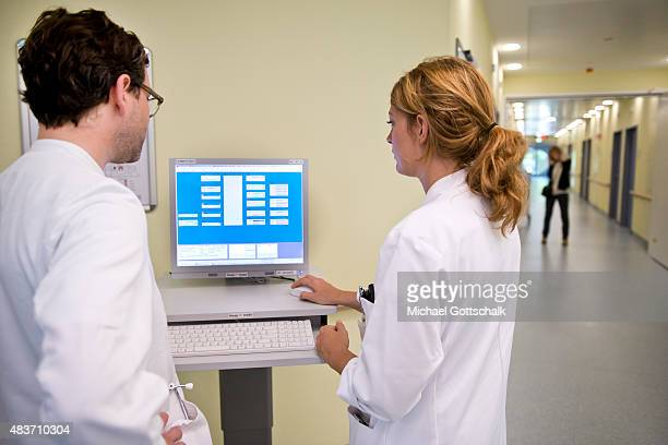Doctors work with a computer terminal to manage patients data on August 12 2015 in Berlin Germany