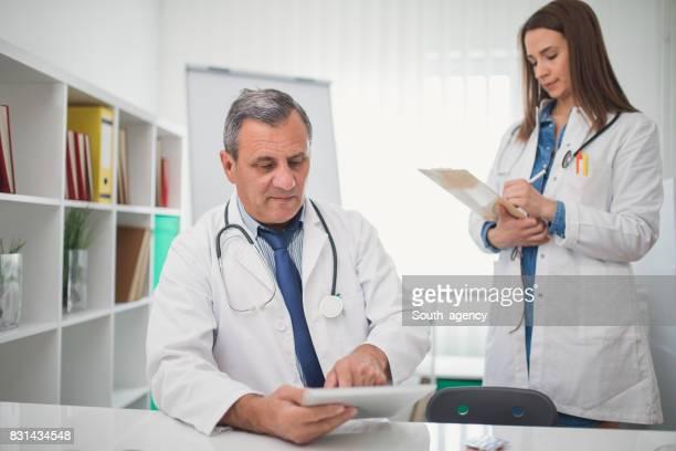 Doctors writing charts