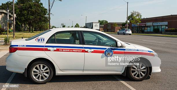 Document service car belonging to Toronto Police at an intersection