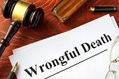 Document with title Wrongful Death o a wooden surface.