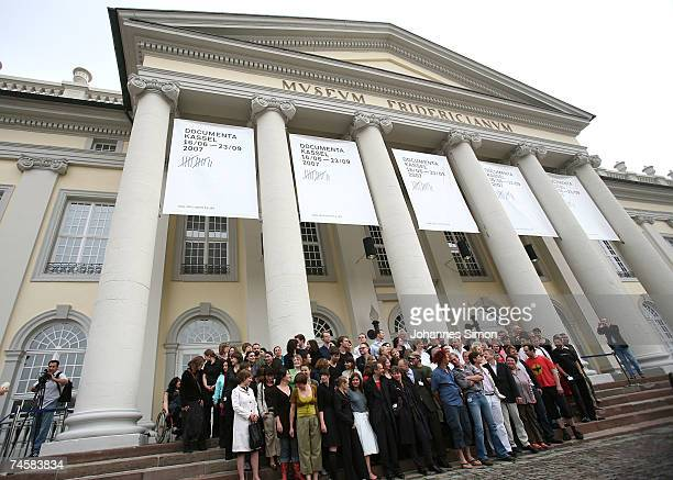 Documenta 12 participating artists pose in front of the Fridericianum museum during the Documenta exhibition photocall on June 13 2007 in Kassel...