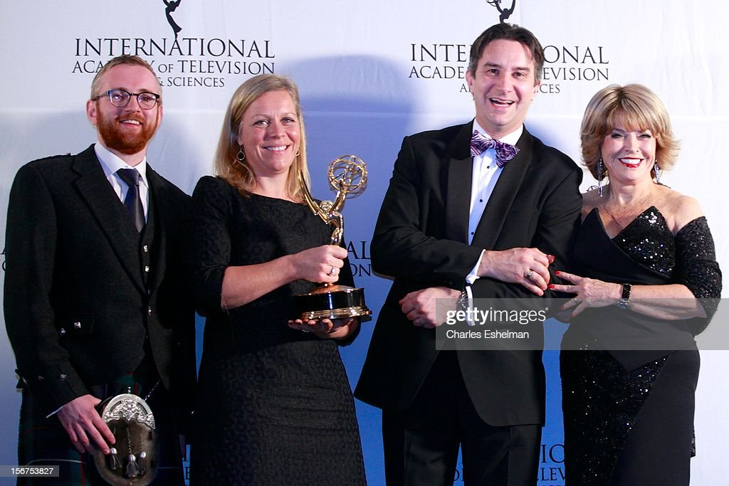 Documentary award winners executive producer Craig Hunter and editor Charlotte Moore, guest, and presenter <a gi-track='captionPersonalityLinkClicked' href=/galleries/search?phrase=Pat+Mitchell&family=editorial&specificpeople=228102 ng-click='$event.stopPropagation()'>Pat Mitchell</a> attend the 40th International Emmy Awards at Mercury Ballroom at the New York Hilton on November 19, 2012 in New York City.