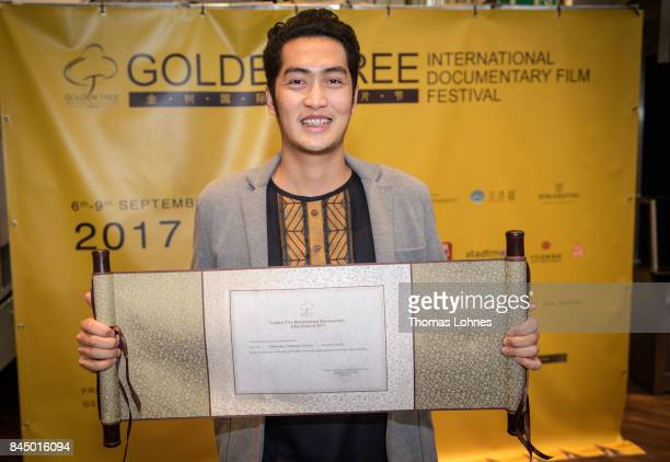 Documentary filmmaker Don Falsario II pictured with his announcement for the shortlist before the Film Festival Award Ceremony on September 9 2017 in...
