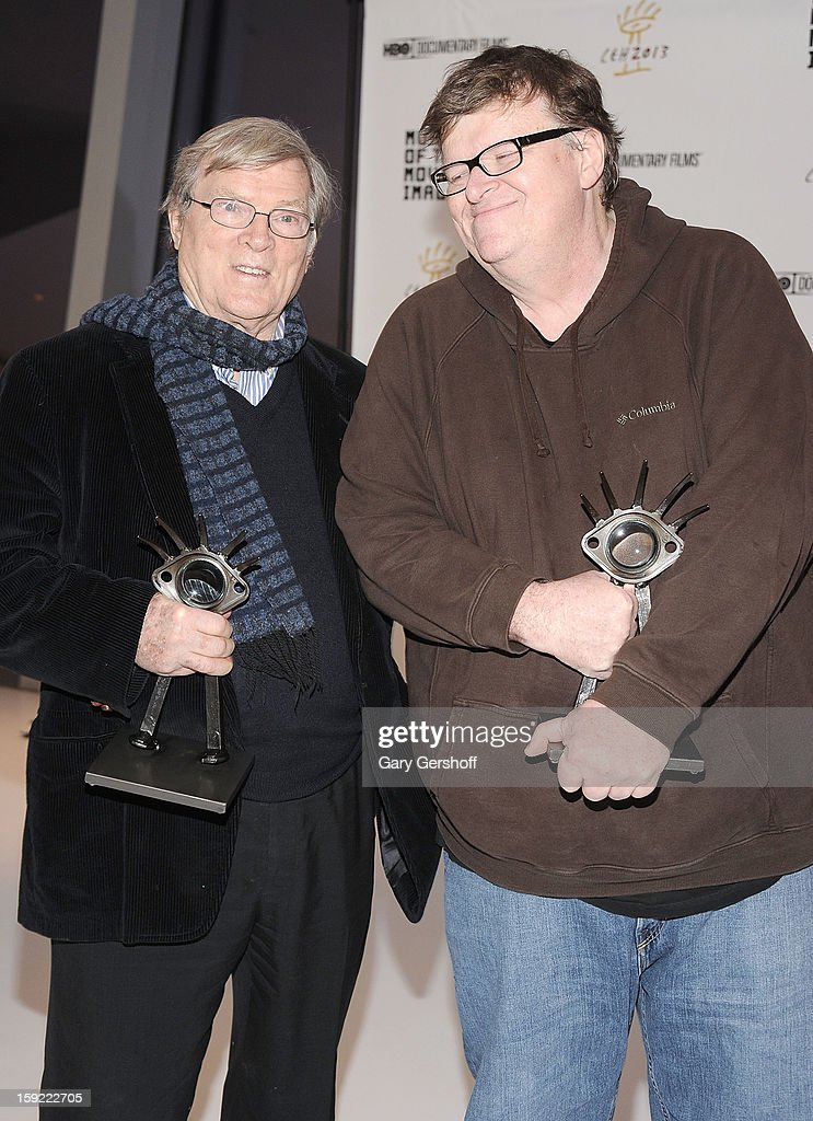 Documentary filmmakers <a gi-track='captionPersonalityLinkClicked' href=/galleries/search?phrase=D.A.+Pennebaker&family=editorial&specificpeople=660590 ng-click='$event.stopPropagation()'>D.A. Pennebaker</a> (L) and <a gi-track='captionPersonalityLinkClicked' href=/galleries/search?phrase=Michael+Moore+-+Director&family=editorial&specificpeople=171693 ng-click='$event.stopPropagation()'>Michael Moore</a> attend the 6th annual Cinema Eye Honors For Nonfiction Filmmaking at Museum of the Moving Image on January 9, 2013 in the Queens borough of New York City.