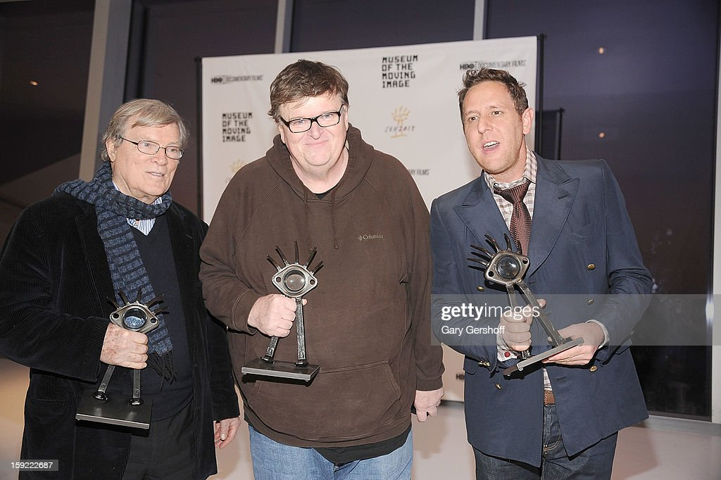 Documentary filmmakers <a gi-track='captionPersonalityLinkClicked' href=/galleries/search?phrase=D.A.+Pennebaker&family=editorial&specificpeople=660590 ng-click='$event.stopPropagation()'>D.A. Pennebaker</a>, <a gi-track='captionPersonalityLinkClicked' href=/galleries/search?phrase=Michael+Moore+-+Director&family=editorial&specificpeople=171693 ng-click='$event.stopPropagation()'>Michael Moore</a> and <a gi-track='captionPersonalityLinkClicked' href=/galleries/search?phrase=Lee+Hirsch&family=editorial&specificpeople=3355686 ng-click='$event.stopPropagation()'>Lee Hirsch</a> attend the 6th annual Cinema Eye Honors For Nonfiction Filmmaking at Museum of the Moving Image on January 9, 2013 in the Queens borough of New York City.