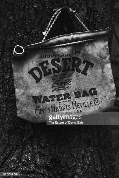 A documentary portrait of an iconic Ames Harris Neville Company Desert Water Bag owned by folk musician and banjo player Billy Faier in August 1964...