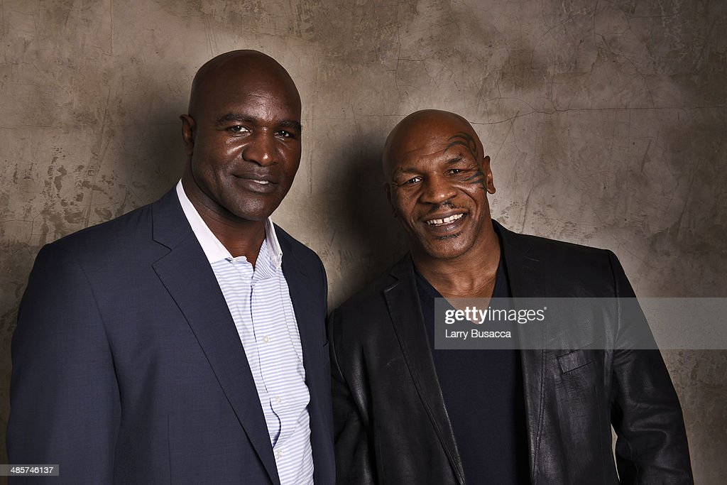 Documentary subjects Evander Holyfield and Mike Tyson from 'Champs', during the 2014 Tribeca Film Festival at the Monarch Room on April 19, 2014 in New York City.