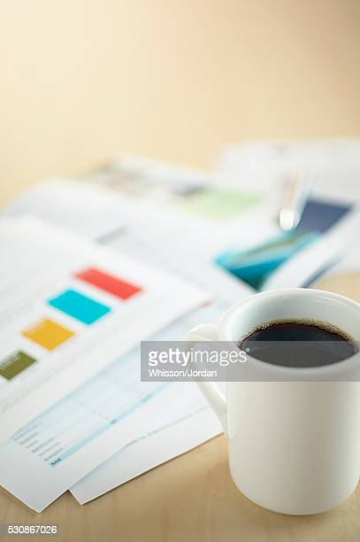 Documents and a coffee cup