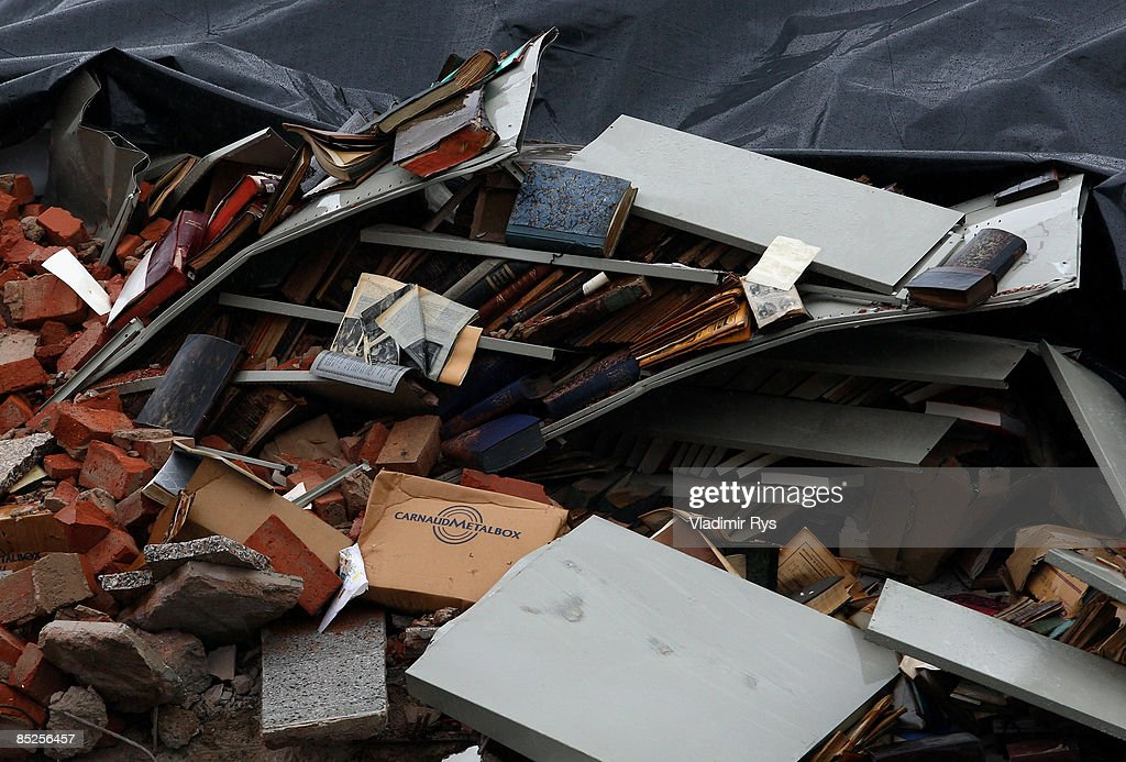 Documents and books lay in the ruine of the building of the Historical Archive of the City of Cologne on March 5, 2009 in Cologne, Germany. Cologne's six-story city archive building groaned then collapsed in a pile of rubble earlier this week. The archive building collapsed about 2 p.m. on Tuesday, ripping open and dragging down parts of two adjacent buildings that contained apartments and an amusement arcade. Two people are still missing. Unofficial voices make the works in process on a new underground 'Nord-Sued' line responsibly which is passing beneath the collapsed building. Cologne has archive material going back over centuries, including manuscripts by communist pioneers Karl Marx and Friedrich Engels and documents related to German writer Heinrich Boell.
