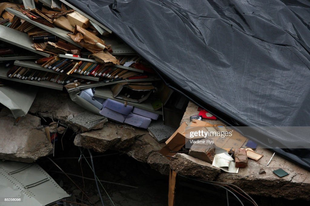 Documents and books lay in the ruine of the Historical Archive of the City of Cologne on March 5, 2009 in Cologne, Germany. The archive building collapsed about 2 p.m. on Tuesday, ripping open and dragging down parts of two adjacent buildings that contained apartments and an amusement arcade. Two people are still missing. Unofficial voices make the works in process on a new underground 'Nord-Sued' line responsible which is passing beneath the collapsed building. Cologne has archive material going back over centuries, including manuscripts by communist pioneers Karl Marx and Friedrich Engels and documents related to German writer Heinrich Boell.