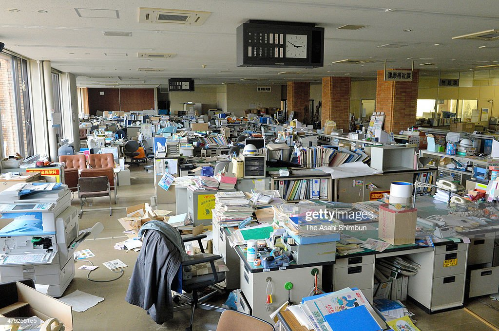 Documents and other files are scattered on the first floor of the Futaba town office on February 25, 2014 in Futaba, Fukushima, Japan. About 96 percent of Futaba, including areas around the town office, has been designated a difficult-to-return zone because annual accumulated radiation levels exceed 50 millisieverts. All 6400 residents have fled the town. In the office, a calendar showing March 2011 still hangs on a wall, while a clock suspended from the ceiling remains stuck at 2:50.