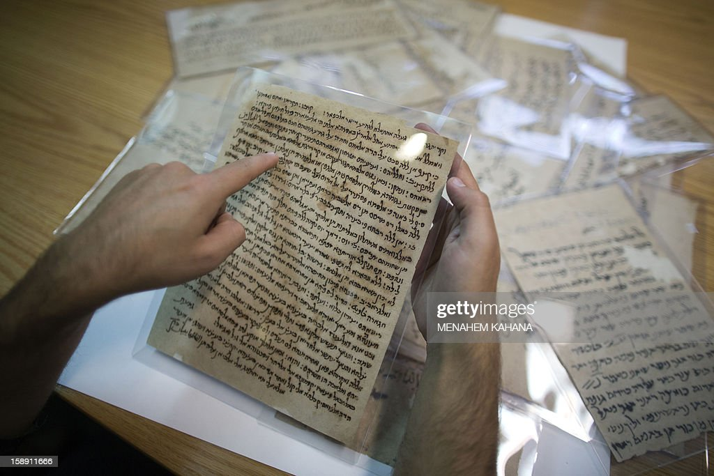 Documents from a collection of discarded religious Jewish, discovered inside caves in a Taliban stronghold in northern Afghanistan, which date back from the 10th century are displayed to the media during a press conference on January 3, 2013, at the national library in Jerusalem. The national library recently acquired 29 items from the collection, or Genizah, which contains the first-ever documentation of the religious, cultural and commercial life of the Jewish community in that era and area. AFP PHOTO/MENAHEM KAHANA