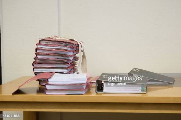 Documents lie on a table in the courtroom at the Landgericht Hannover courthouse for the second day of the trial to Former German President Christian...