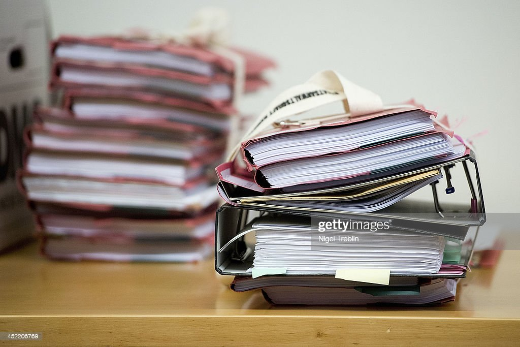 Documents lie on a table in the courtroom at the Landgericht Hannover courthouse for the second day of his trial on November 27, 2013 in Hanover, Germany. Wulff is accused of accepting favors while he was governor of Lower Saxony, a charge that prompted him to resign last year from his office as president. Wulff is the first post-World War II German president to face a court trial.