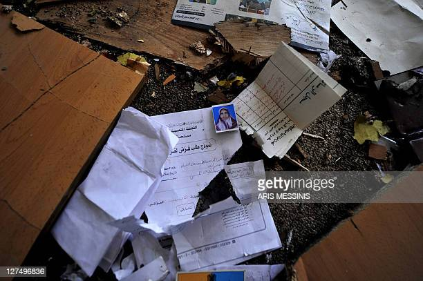 Documents lie on the ground at the local headquarters of Libya's ousted regime in Tawarga on September 25 2011 The people of Tawarga who are mostly...