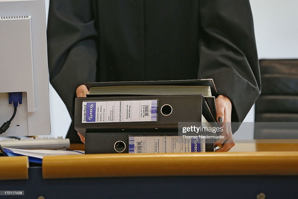 Documents of accused Russian spies with the aliases Andreas and Heidrun Anschlag appear in court on the last day of their trial on July 2, 2013 in Stuttgart, Germany. The couple came to Germany in 1988, reportedly as KGB spies, and continued operating for the modern Russian intelligence service while maintaining a front as immigrants from South America until their arrest in late 2011 by German police. Among the couple's biggest coups was recruiting Dutch Foreign Ministry worker Raymond Valentino Poeteray, who sold them top secret NATO documents. The couple also had a daughter while living in Germany who is now in her early 20's and reportedly knew nothing of her parents' true identity and espionage activities. German law enforcement authorities came onto the Anschlags' trail following the arrests last year of 10 Russian spies in the United States.