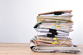 Stack documents pace on wood desk in office