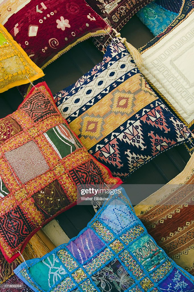 Dodecanese Islands, Rhodes Town: Rhodes Old Town, Fabrics and pillows for sale, Greece