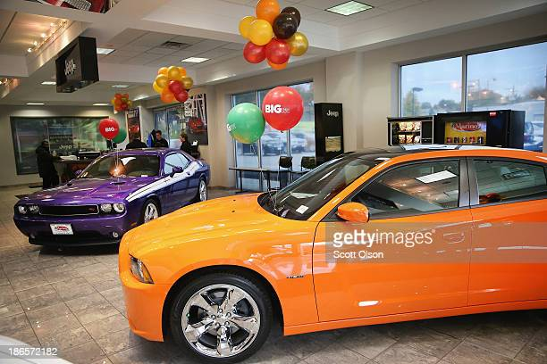 Dodge Challenger and Chargerwhich are made by The Chrysler Group are offered for sale at the Marino Chrysler Jeep Dodge dealership on November 1 2013...