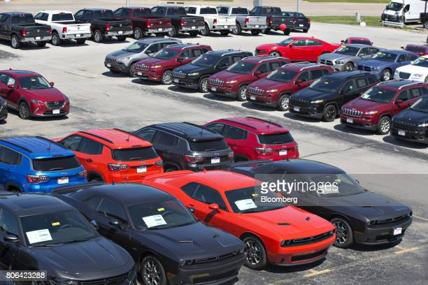 Dodge Challenger cars front sit next to Fiat Chrysler Automobiles vehicles at a car dealership in Moline Illinois US on Saturday July 1 2017 Ward's...