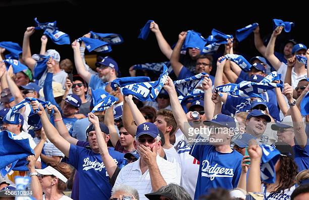 Dodger fans cheer during Game One of the National League Division Series against the St Louis Cardinals at Dodger Stadium on October 3 2014 in Los...