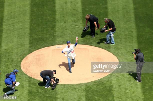 Dodger Hall of Fame pitcher Sandy Koufax throws out the ceremonial first pitch of the game between the Los Angeles Dodgers and the San Francisco...