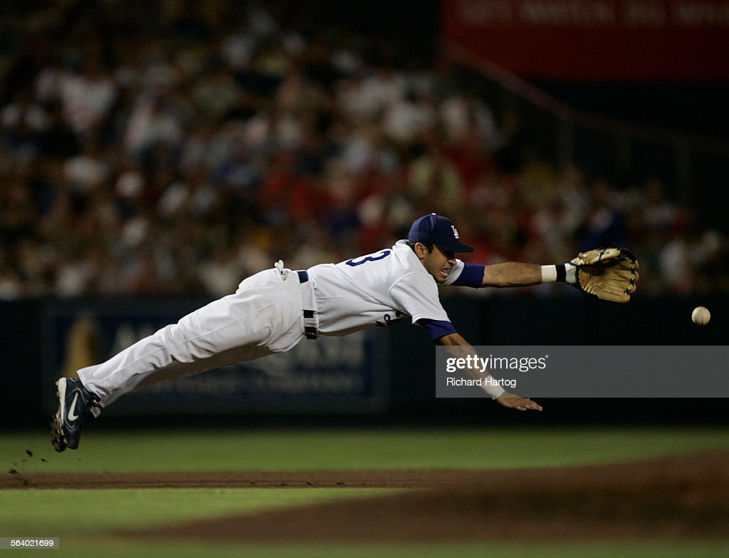 Dodger thirdbaseman Oscar Robles gets horizontal but he can't makes the diving catch on a base hit by St Louis Cardinal Mike Mahoney during fifth...
