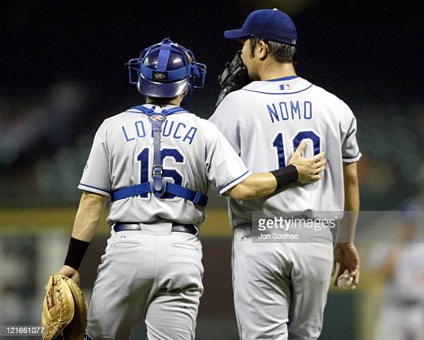 Dodgers catcher Paul Loduca consoles starting pitcher Hideo Nomo in the first inning after giving up four runs to the Astros