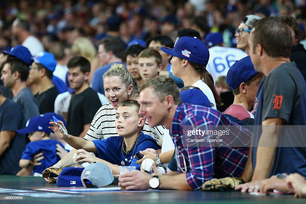Dodgers fans ask for autographs prior to the opening match of the MLB season between the Los Angeles Dodgers and the Arizona Diamondbacks at Sydney Cricket Ground on March 22, 2014 in Sydney, Australia.