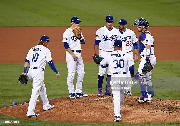 Dodgers manager Dave Roberts visits the mound to pull Los Angeles Dodgers Pitcher Julio Urias form the game in the fourth inning during game four of...