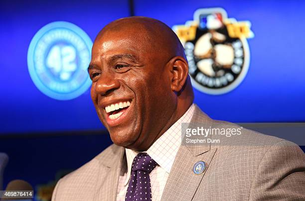 Dodgers owner Magic Johnson smiles at a press conference before the Jackie Robinson Day game between the Seattle Mariners and the Los Angeles Dodgers...
