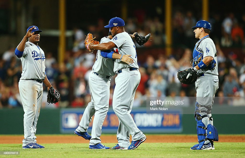 Dodgers players celebrate winning the opening match of the MLB season between the Los Angeles Dodgers and the Arizona Diamondbacks at Sydney Cricket Ground on March 22, 2014 in Sydney, Australia.