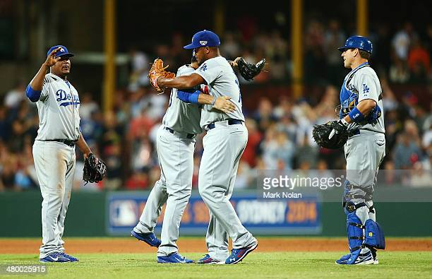 Dodgers players celebrate winning the opening match of the MLB season between the Los Angeles Dodgers and the Arizona Diamondbacks at Sydney Cricket...