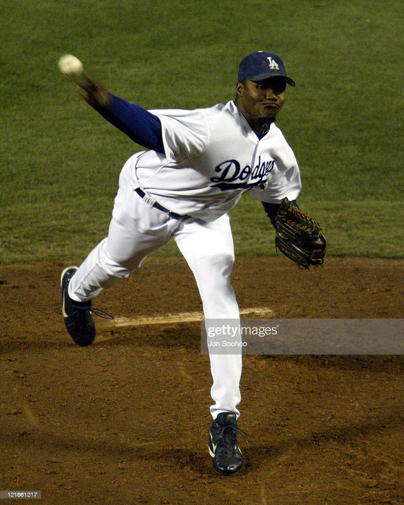 Los Angeles Dodgers vs Colorado Rockies - August 30, 2003. Dodgers reliever <a gi-track='captionPersonalityLinkClicked' href=/galleries/search?phrase=Guillermo+Mota&family=editorial&specificpeople=208080 ng-click='$event.stopPropagation()'>Guillermo Mota</a>. Dodgers win 5 - 0