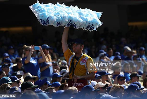 Dodgers Stadium vendor sells cotton candy during the MLB game between the San Diego Padres and the Los Angeles Dodgers at Dodger Stadium on September...