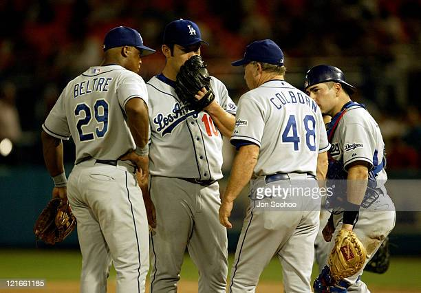 Dodgers starter Hideo Nomo talks to pitching coach Jim Colborn in the 6th inning