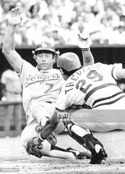 Dodgers' Steve Yeager is tagged out at the plate by Reds catcher Alex Trevino as he attempted to score fro' second base on a 2nd inning hit to right...