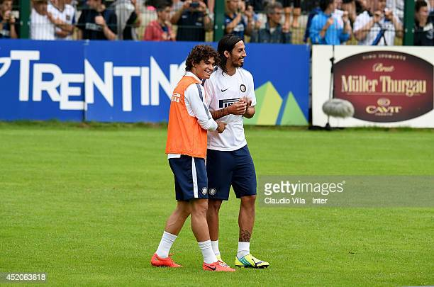 Dodo and Ezequiel Schelotto during of FC Internazionale Milano training session on July 12 2014 in Pinzolo near Trento Italy