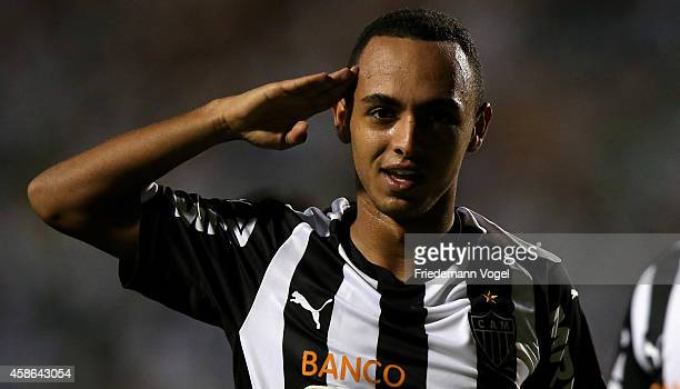 Dodo of Atletico celebrates scoring the second goal during the match between Palmeiras and Atletico MG for the Brazilian Series A 2014 at Pacaembu...
