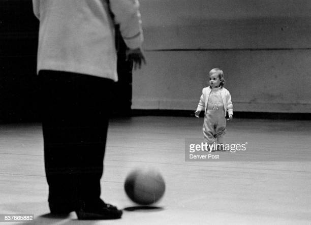 Doesn't want to Play 15 month old Rachel Miner just couldn't get interested in the basketball her mom Cathy Sunday at the Sunset Beach and Raquet...