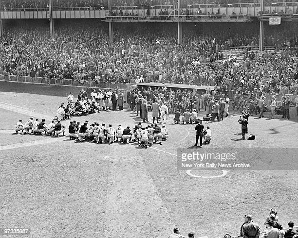 Doffing his familiar cap and waving his hand the Bambino grins as 58339 fans who packed Yankee Stadium roar a welcome to baseball's alltime hero Babe...